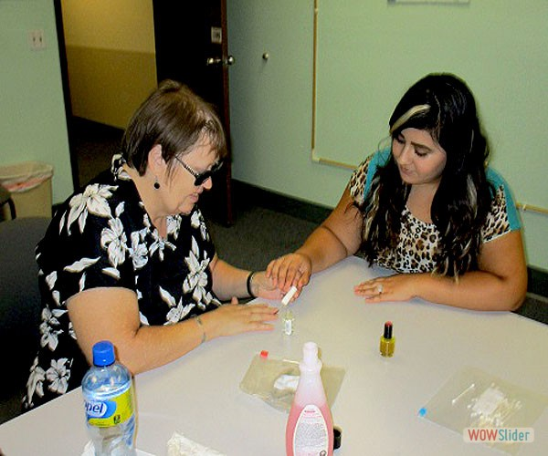 Teresa is learning how to paint her nails with her independent living skills instructor.
