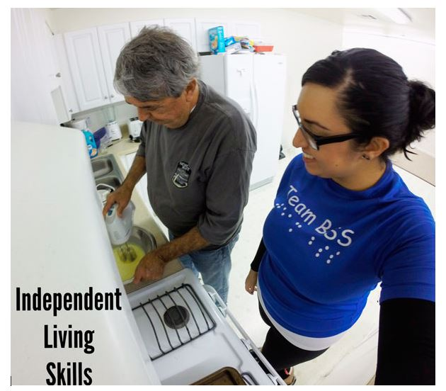 Independent living skills instructor teaching a blind student how to cook